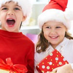 Group of four children in Christmas hat with presents; Shutterstock ID 89220517; PO: purchase_order4; Job: job1; Client: client2; Other: other3